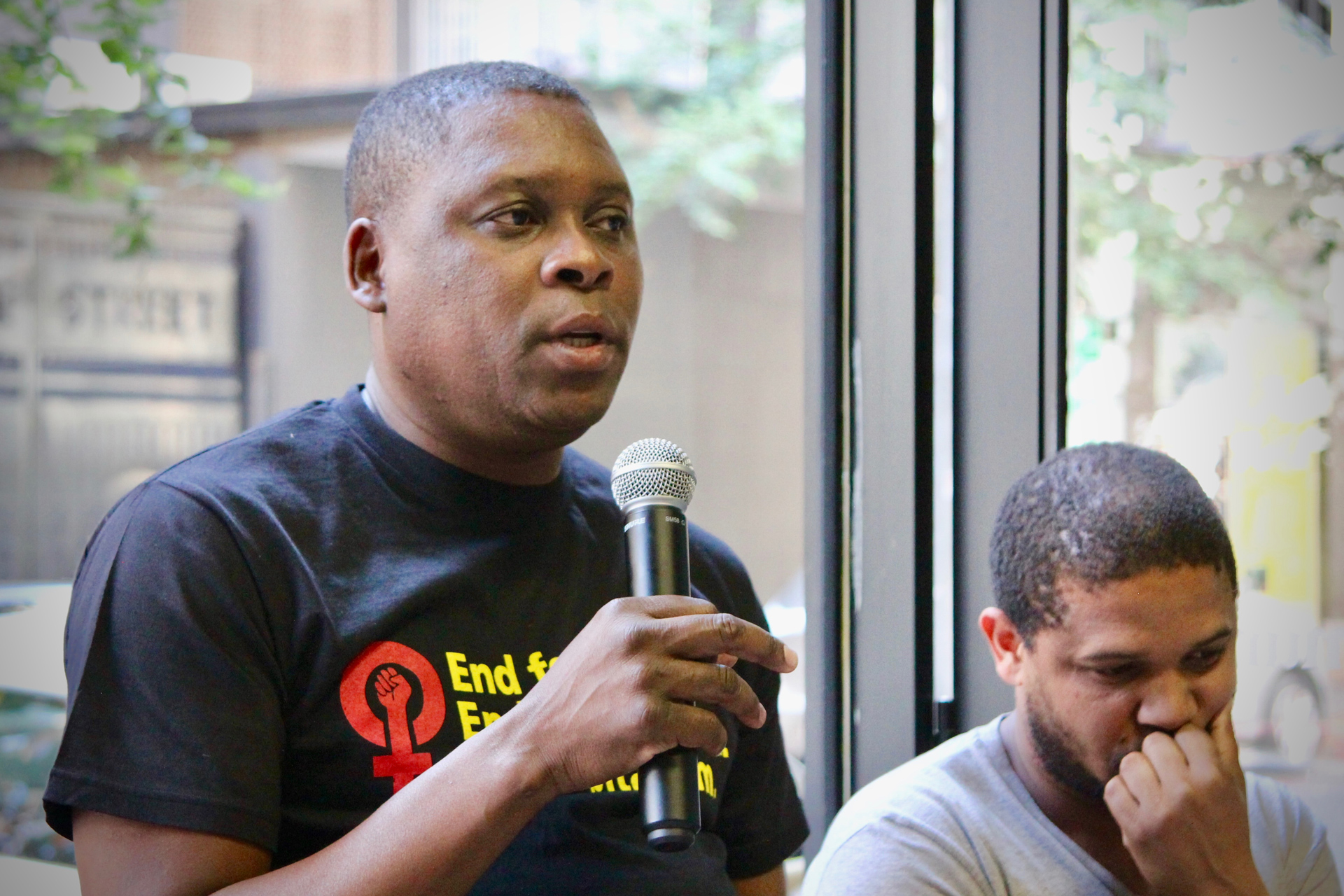 Mbuso Ngubane speaking as a panelist at the opening of The Commune